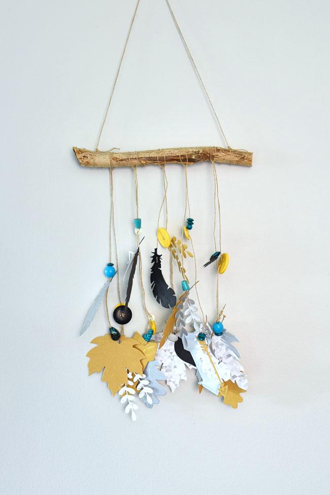 A Fun DIY Feather And Foliage Cardstock Mobile Using The Cricut Cuttlebug