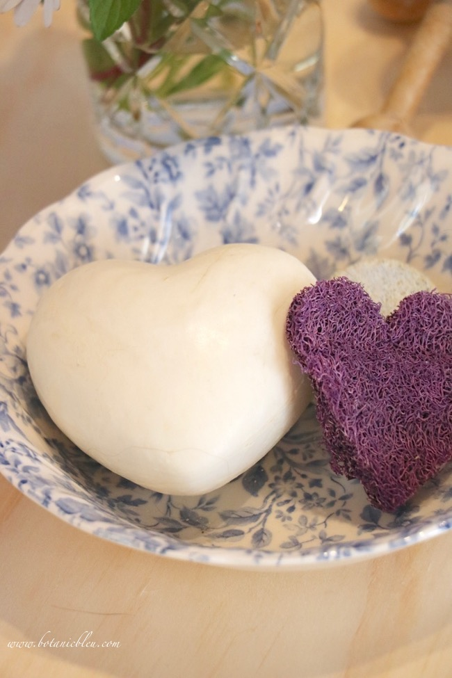 romantic master bath French beauty products of Paris heart soap and purple loofah