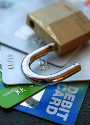 credit cards and open padlock
