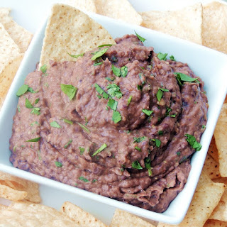 Chipotle black bean dip in a white bowl close up.