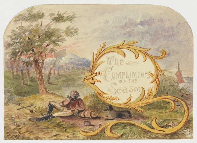 """Christmas Card design depicting a bushman reclining against a log smoking a pipe with the words """"The Compliments of the Season""""."""