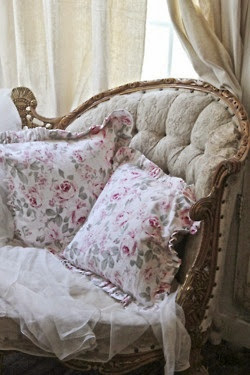 romantic rose floral print cushions in an antique chair