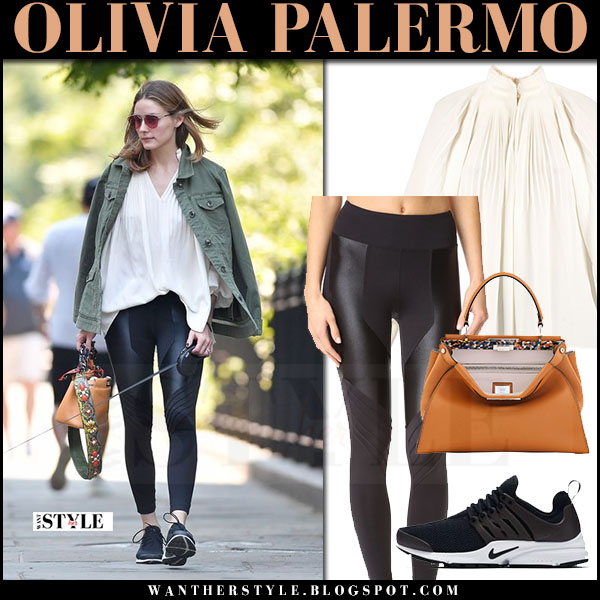 Olivia Palermo in army green jacket, cream pleat tibi blouse and black koral leggings walking her dog june 10 2017 what she wore