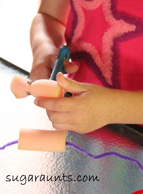 Kids can improve fine motor skills using foam curlers.