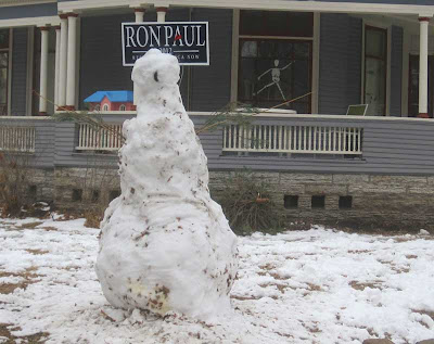 8 foot tall snow man with Ron Paul campaign sign bisecting its head