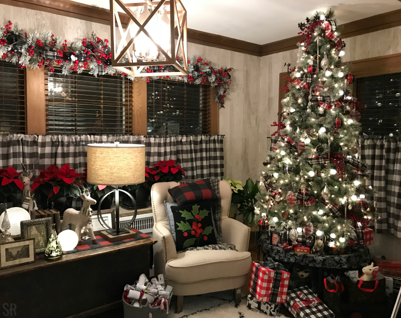 a living room decorated in plaid Christmas decorations