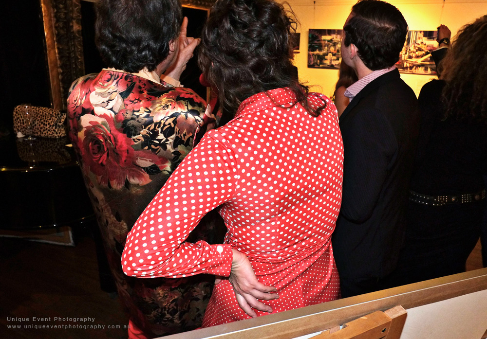 Charles and a woman in red spotted blouse, The Billich Gallery 30th Anniversary 'Erotica' Party - Photographed by Kent Johnson for Unique Event Photography.