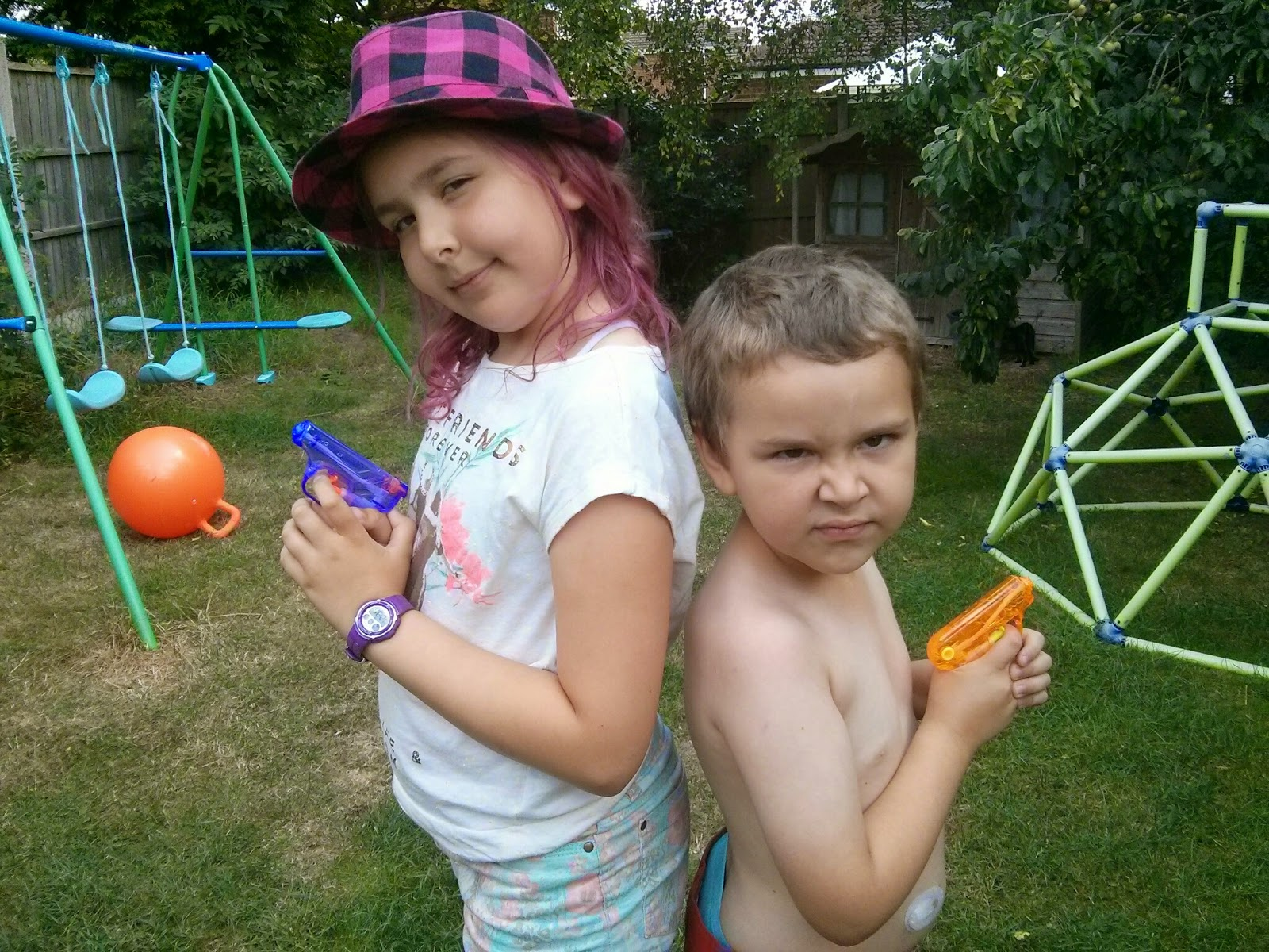 Top Ender and Big Boy posing with their water guns