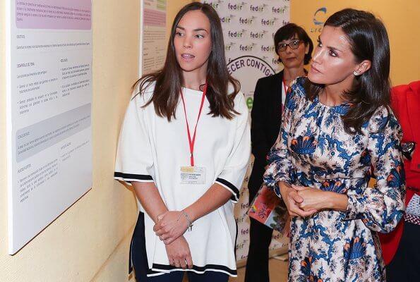 Queen Letizia wore Sandro all-over print long silk dress. Queen Letizia wore Carolina Herrera nude patent leather slingback pumps