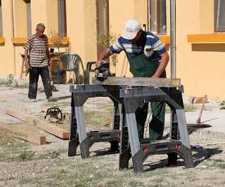 Bekir smoothing beams for the wood store