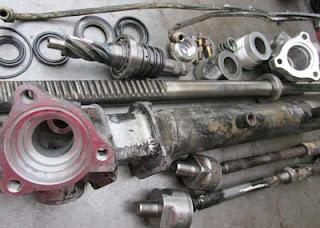 Componentes de cremallera de dirección hidráulica Nissan