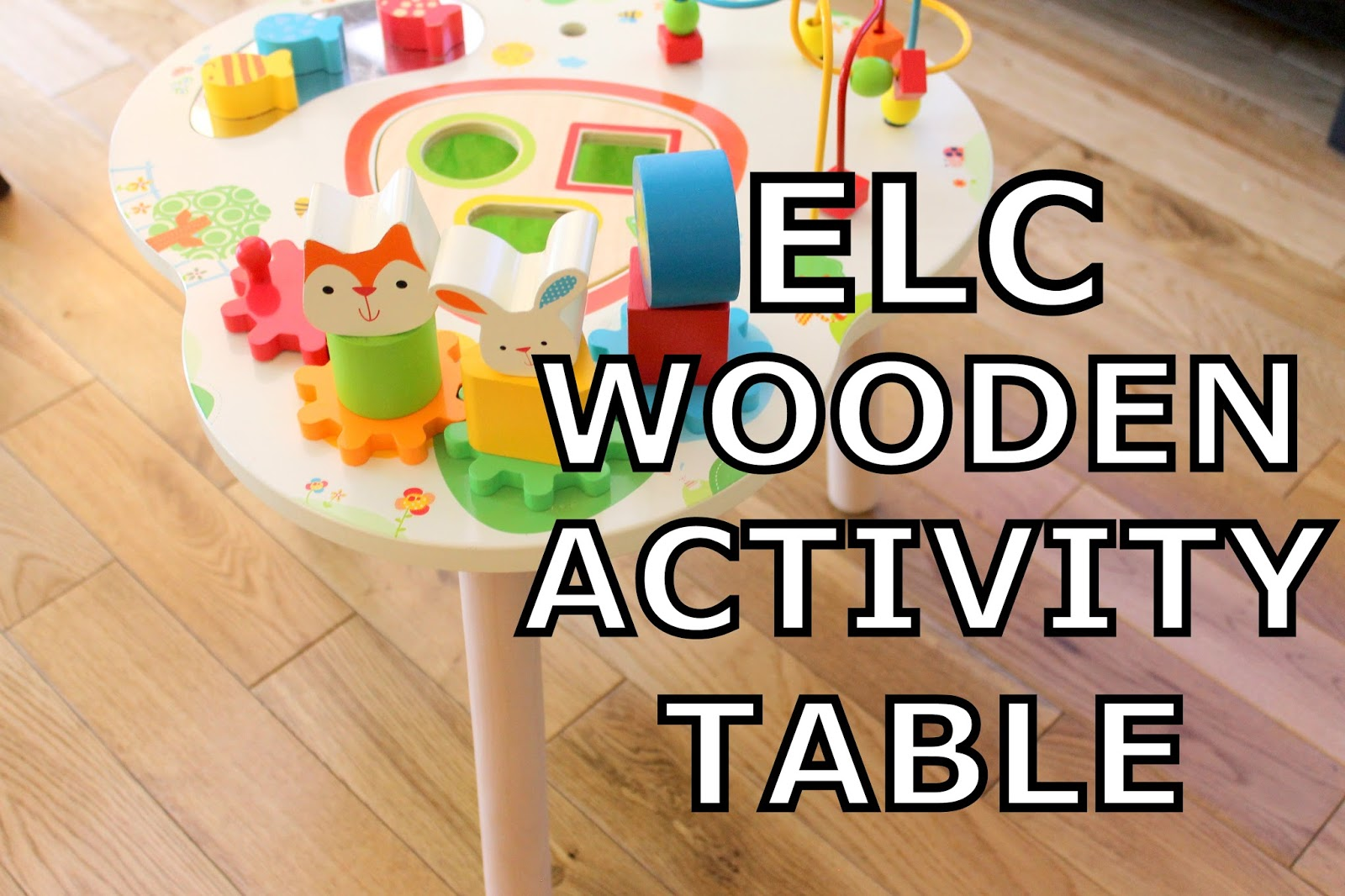 A Brightly Coloured Wooden Activity Table That Has Lots Of Different Games  For Your Little One.