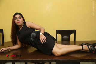 Tollywood Upcoming Actress Pooja Roshan Stills in Black Short Dress at Plus 1 Movie Trailer Launch  0363.JPG