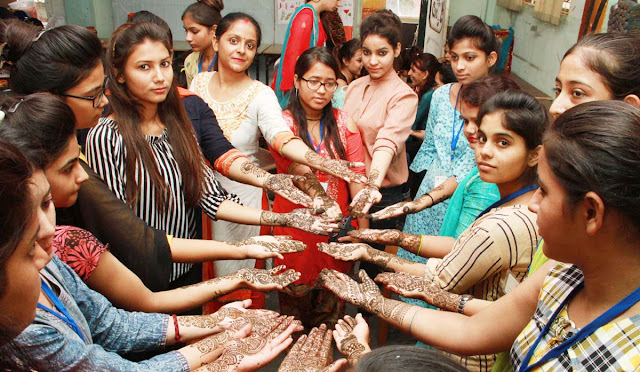 Organizing Mehndi Competition on Rakhi Festival in Savitri Polytechnic