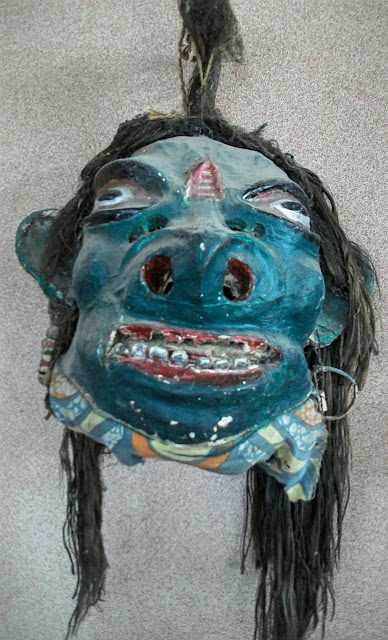 This image of a macabre mask is on display in the museum of Auniati Satra. The traditional craft of mask making is now facing the threat of extinction. Today, in Majuli, masks are only made at Samaguri Satra.