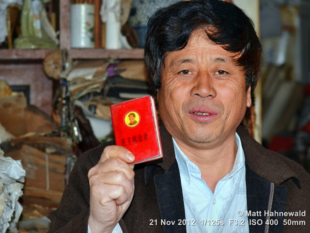 people; Chinese people; Chinese man; portrait; street portrait; headshot; South China; Yunnan province; Kunming; Mao's little red book; close up
