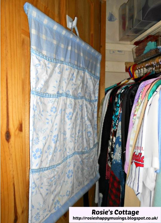Pretty gingham & floral pocket storage unit fits perfectly inside the closet door.