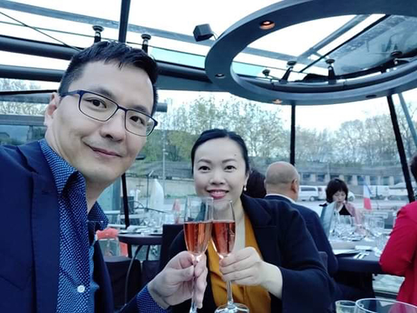 Toasting at the beginning of our dinner cruise on the Seine