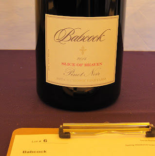 Bottle of pinot noir, Slice of Heaven, on auction table at SB Vintners Festival