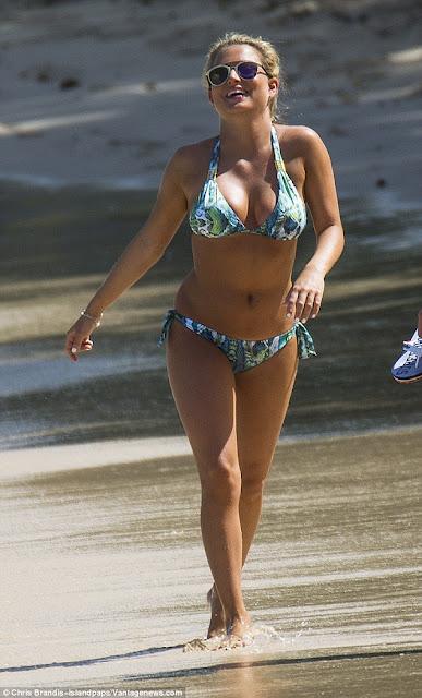 Zara Holland in a sexy snake print bikini
