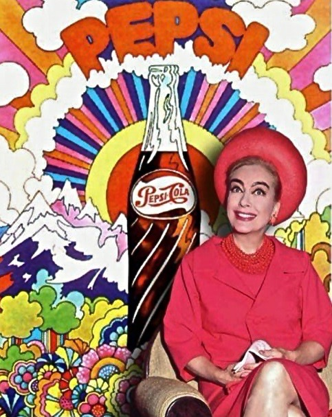 Joan Crawford sits in front of a John alcorn illustrated pepsi advertisement 1969.jpg