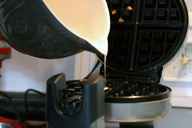 pouring the gluten free rice flour batter into the waffle maker