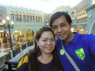 A couple travel blogger exploring The Venetian Hotel Macao for their Macau Travel Guide
