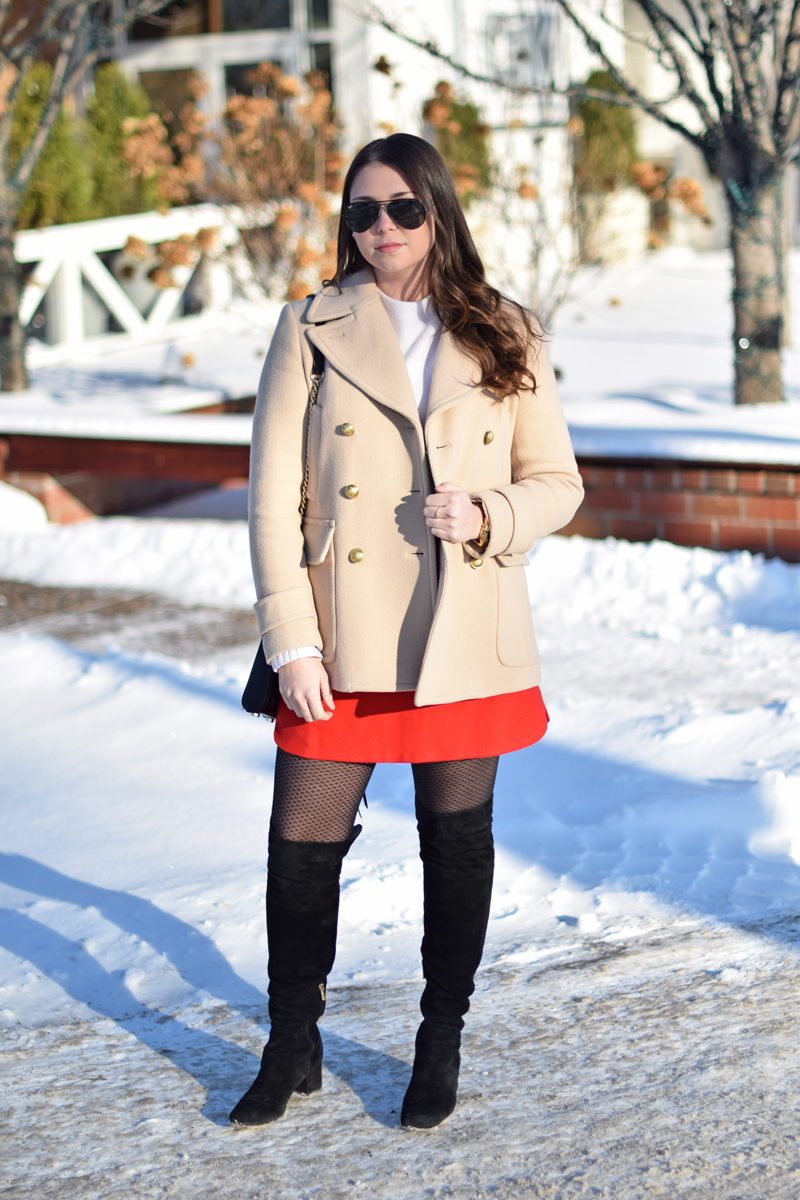 Rich colors and over the knee boots on stylish woman.