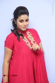 Actress Poorna Latest Stills in Red Dress at Rakshasi First Look Launch  0123.JPG