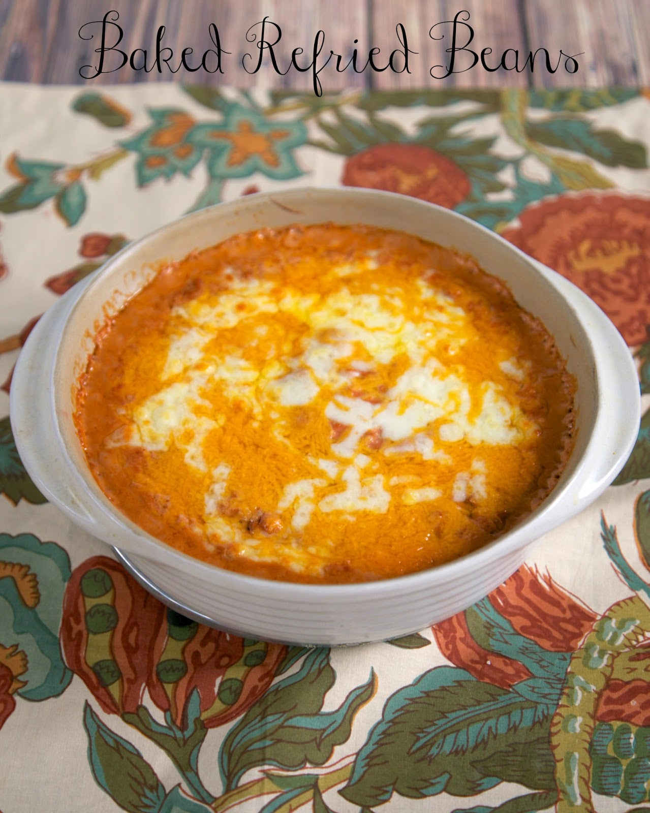The BEST Baked Refried Beans Recipe - beans, sour cream and salsa - ready in minutes! My husband hates refried beans, but gobbled these up! Also great as a dip!