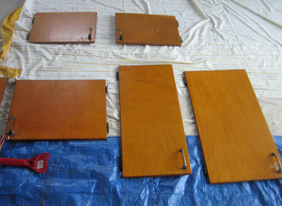 Lay out doors: Painting old cabinets Recycled Cabinet Doors | DIY Playbook