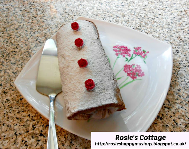 Extra yummy and super easy to make chocolate Swiss roll with roses