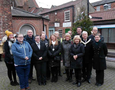 Andrew Percy MP, Coun Rob Waltham, Brigg Town Mayor Coun Donald Campbell, Mayoress Coun Tina Campbell, Brigg Town Business Partnership officials, charity representatives and sponsors after the Tree of Light service with the Rev Trudy Hobson, right - January 5, 2019