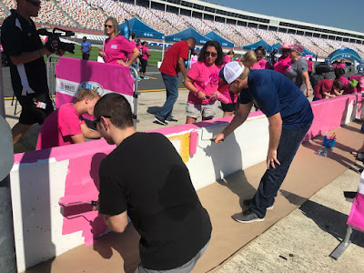 Jimmie Johnson, DeAngelo Williams and NASCAR Drivers Join Breast Cancer Survivors to Paint Pit Wall Pink