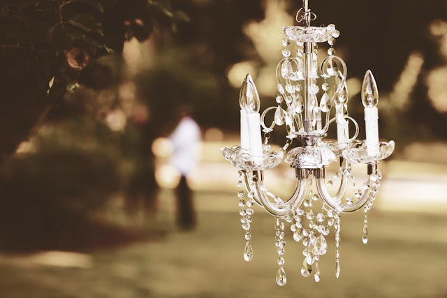 shallow-focus-photography-of-white-uplight-chandelier