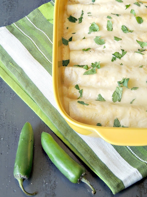 Easy Creamy Green Chile Chicken Enchiladas are extra creamy, extra cheesy, and just a bit spicy, these easy green chile enchiladas are sure to become a family favorite! From www.bobbiskozykitchen.com