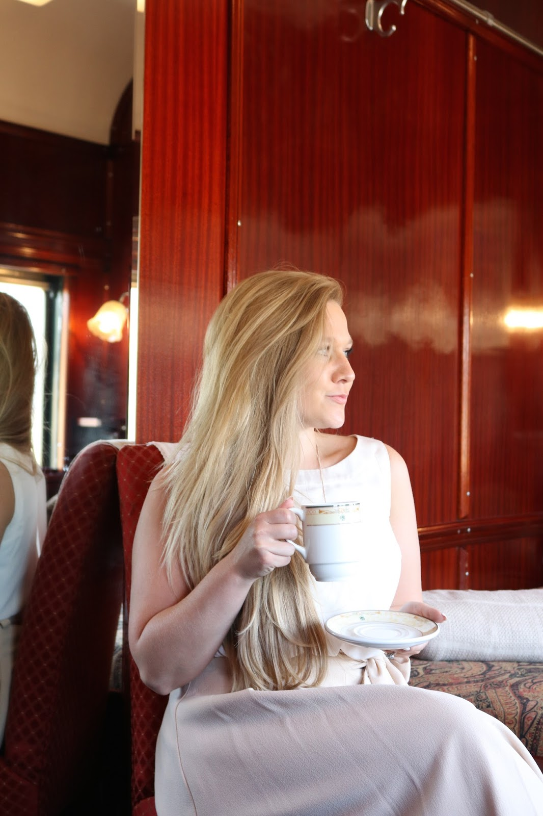 Katie Heath drinking tea in the room aboard Rovos Rail