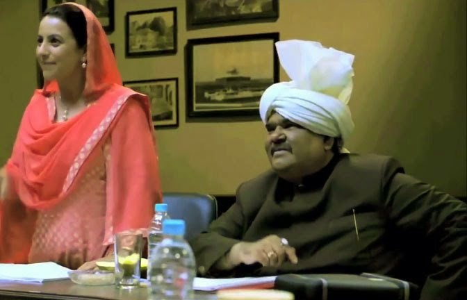 Satish Kaushik as Minister of State for Defence Harpool Choudhry, in Jai Ho! Democracy (2015), Co-directed by Ranjit Kapoor and Bikramjeet Singh Bhullar