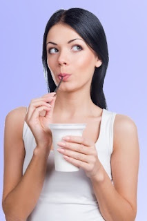 woman pondering yogurt