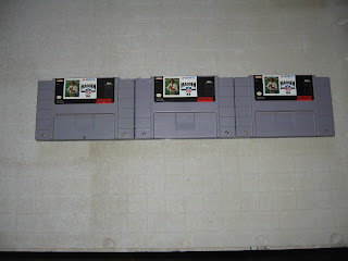game urinal three snes cartridges
