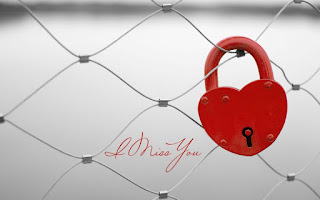 i miss you with red heart shaped lock
