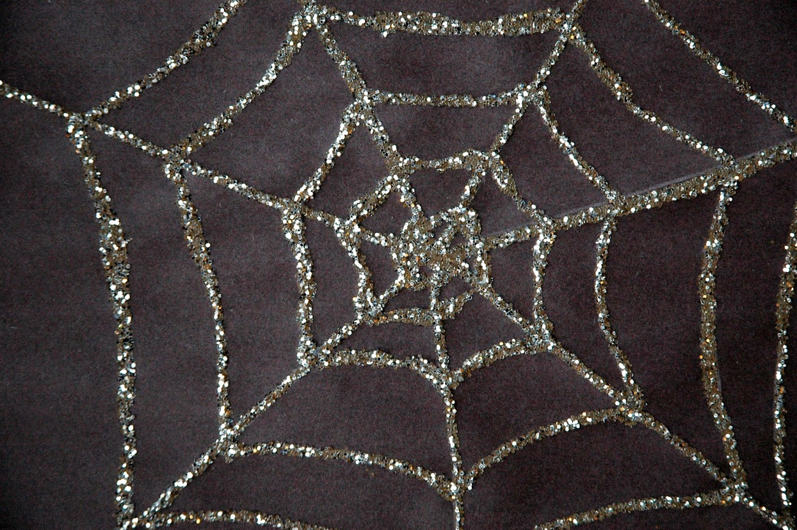 finished product sparkly spiderweb halloween craft