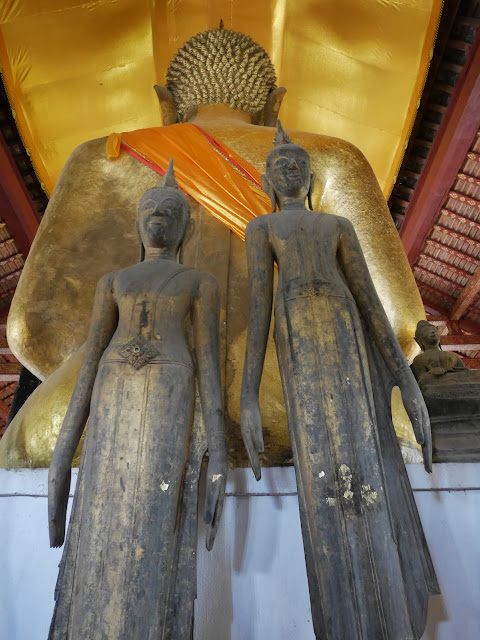 two Luang Prabang-style standing Buddha statues