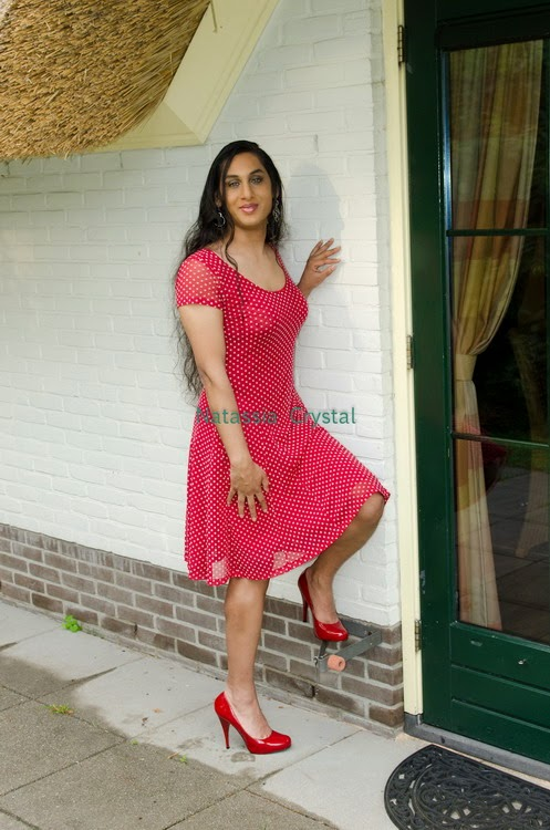Natassia Crystal natcrys, red polka-dot dress, outside posing at door