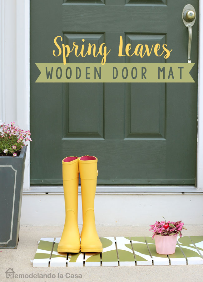 Spring leaves design on wooden door mat at the main entrance door. two designs in one
