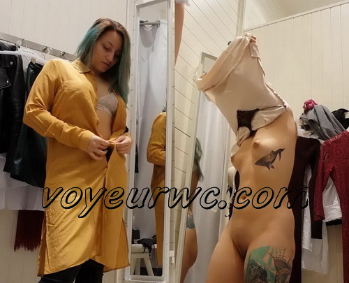 SpyCam 2389-2398 (Shopping Mall changing room. Hidden cam - Girl trying on swimsuits and dresses)