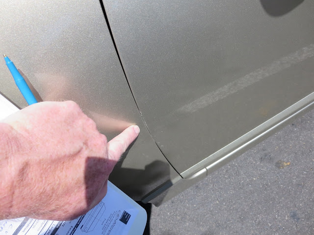 2008 Honda Civic with fender scraping on top of door prior to repairs