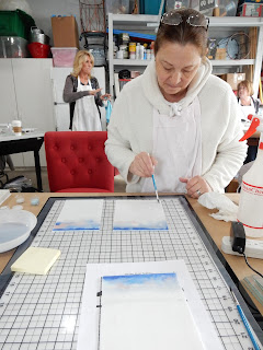 Guild member Andrea Tatkon-Coker works on her sky