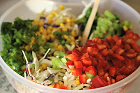 Firecracker Coleslaw by Renee's Kitchen Adventures ready to mix in a white bowl with a wooden spoon