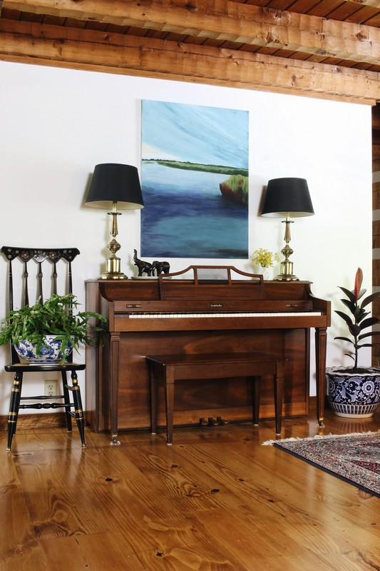 log-cabin-wide-plank-pine-floor-piano-art